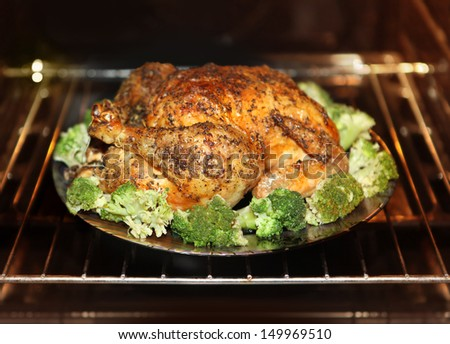 cooking roast turkey and cabbage in the oven - stock photo