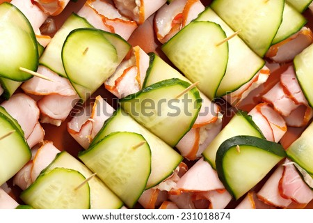 Cooking roll with meat, cucumber, horseradish and sauerkraut. - stock photo