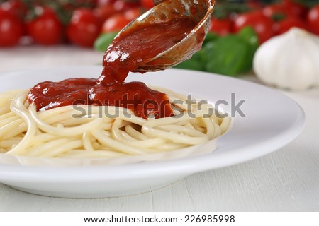 Cooking spaghetti noodles pasta: serving tomato sauce Napoli on plate