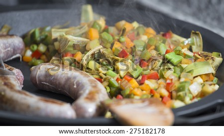 Cooking Spanish veggies paella