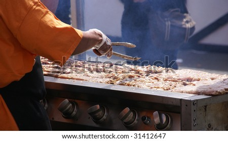 Cooking spicy kebabs at street fair,    Pacific Northwest