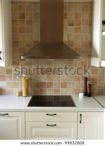 Cooking stove in modern kitchen - stock photo