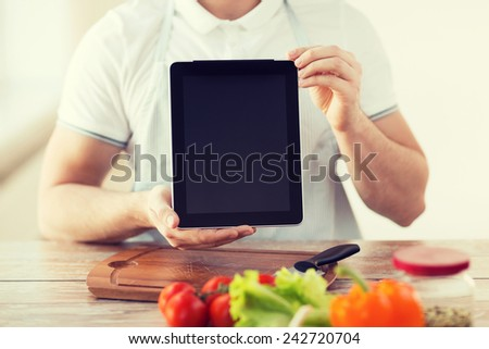 cooking, technology, advertising and home concept - close up of male hands holding tablet pc with blank black screen - stock photo
