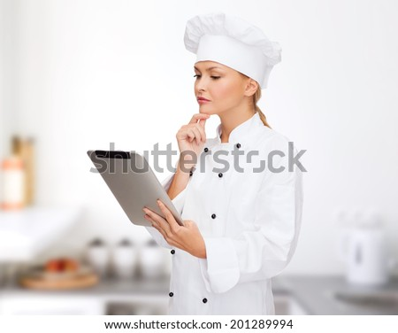 cooking, technology and food concept - smiling female chef, cook or baker with tablet pc computer - stock photo