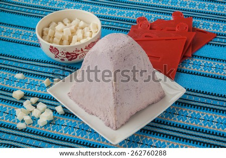 Cooking the traditional Easter dessert from cottage cheese and slices of coconut on the eve of Easter - stock photo
