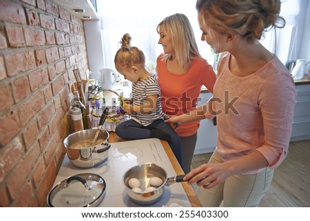 Cooking together for Easter breakfast  - stock photo
