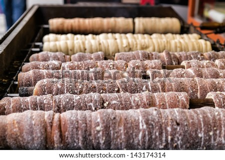 Cooking trdelnik also known as Trdlo is a czech traditional sweet pastry. - stock photo