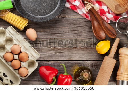 Cooking utensils and ingredients on wooden table. Top view with copy space - stock photo