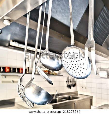 Cooking utensils in a kitchen - stock photo