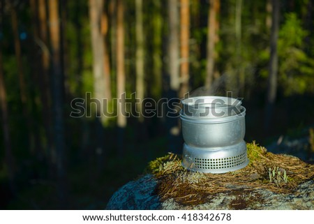 Cooking with camping stove - stock photo