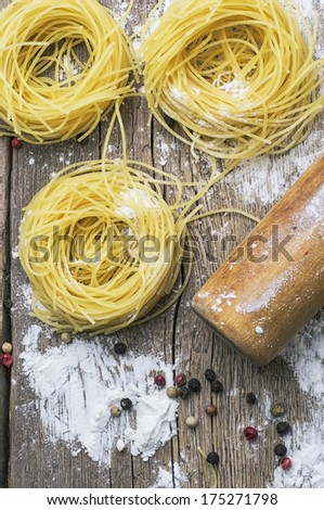 cooking with delicious Italian pasta - stock photo