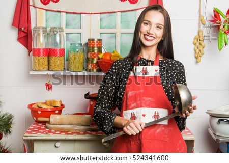 Cooking woman in kitchen. The kitchen is decorated in old Russian style