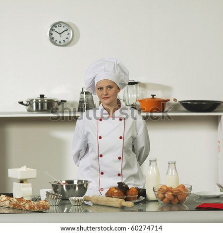 cooking woman in professional uniform - stock photo