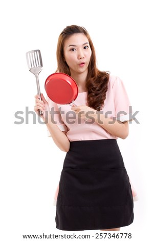 cooking woman or housewife, hand holding spatula and pan - stock photo