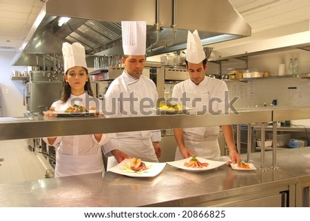 cooks in a kitchen of a restaurant - stock photo