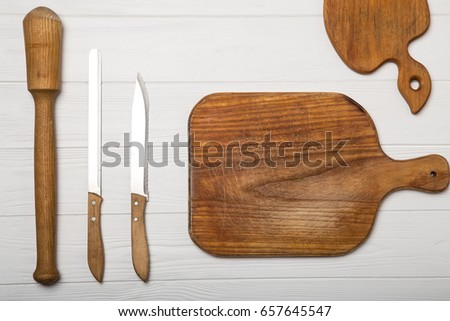 Cookware board in the form of apples, knife, rolling pin