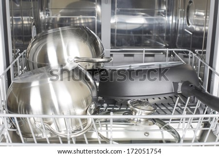 cookware in the dishwasher after washing and drying - stock photo