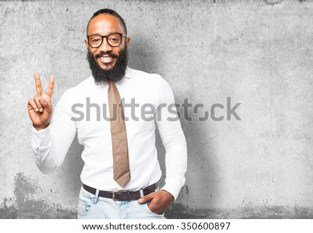 cool black man doing victory gesture