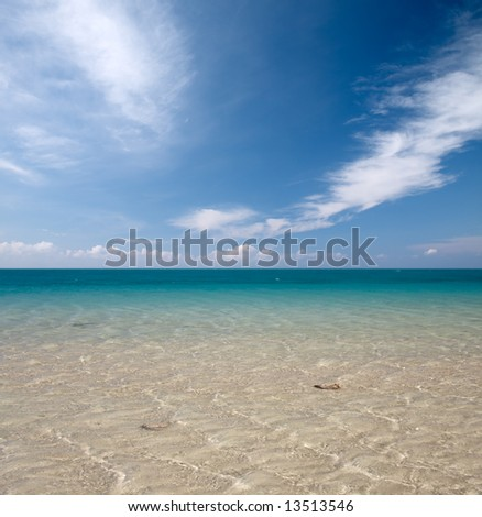 cool blue sea water and sky with clouds