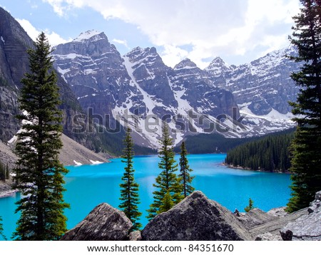 Cool blue water of Moraine Lake in Banff National Park, Canada - stock photo