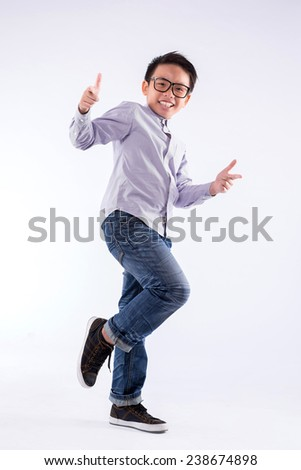 Cool boy in glasses making hand gesture and looking at the camera - stock photo
