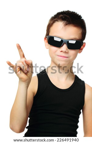 Cool boy in sunglasses gesturing isolated on white background - stock photo