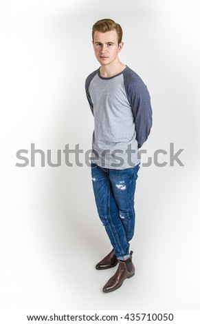 cool boy with cool facial expression  poses in studio isolated on white