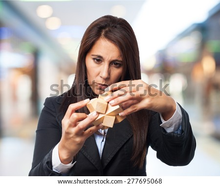 cool business-woman with puzzle cube - stock photo