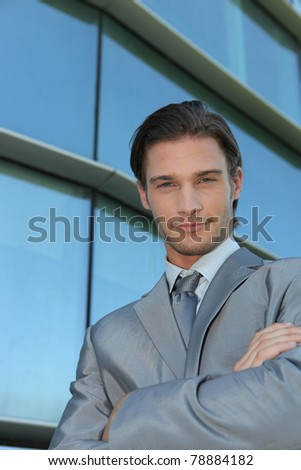 Cool businessman outside an office building - stock photo