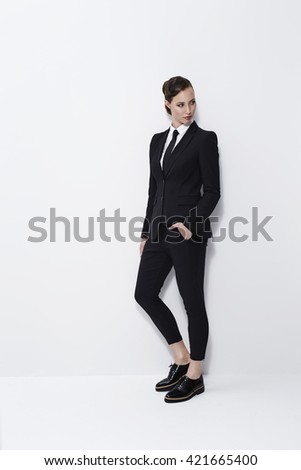 Cool businesswoman looking away