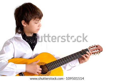 Cool child in the school of music on a white background