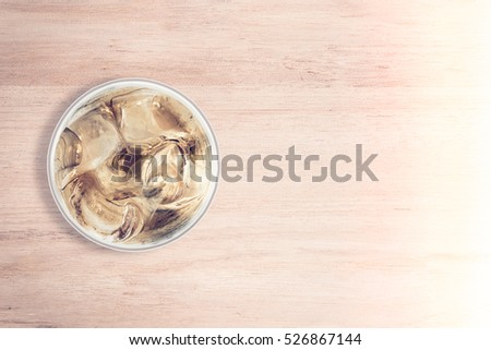 cool drink in glass place at left side wood texture background, add vintage tone effect