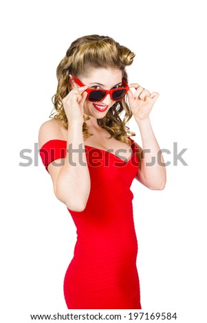 Cool fashionable blond pinup girl adjusting sunglasses to flashback a 1950s look with matching rockabilly dress on white background - stock photo