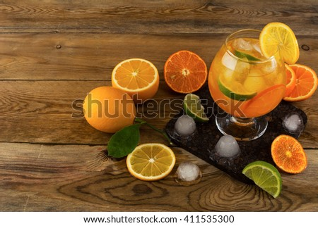Cool fruit cocktail on wooden table, copy space. Fruit cocktail. Fruit drink. Citrus lemonade. Fruit lemonade. Summer drink  - stock photo