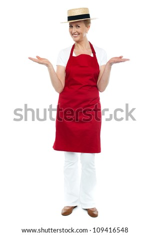 Cool full length portrait of female chef isolated over white