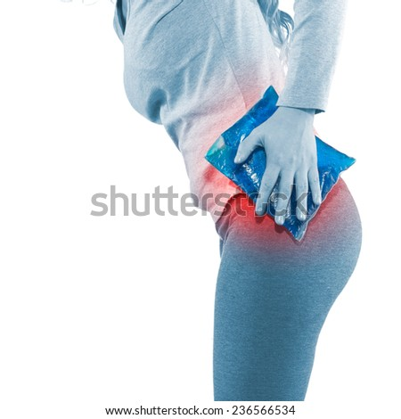 Cool gel pack on a swollen hurting hip. Medical concept photo. - stock photo