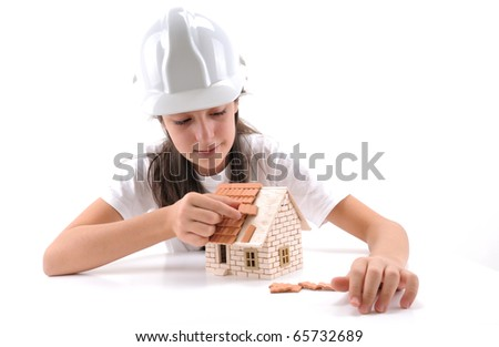 Cool girl building house isolated on white - a series of BUILDING A HOUSE images. - stock photo