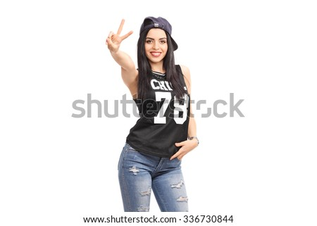Cool girl in hip-hop clothes making a hand sign and looking at the camera isolated on white background - stock photo