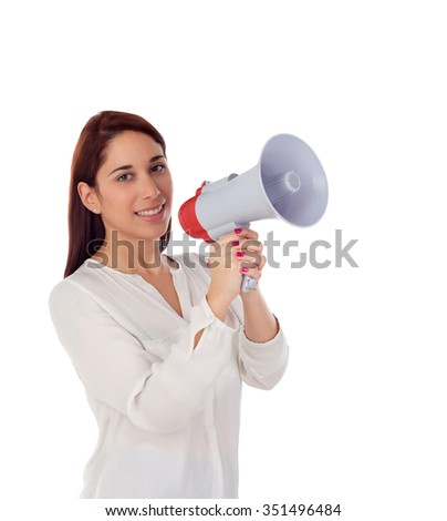 Cool girl speaking through a megaphone isolated on a white background