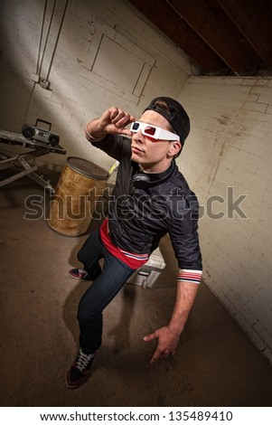 Cool hip hop white guy with 3D glasses indoors - stock photo