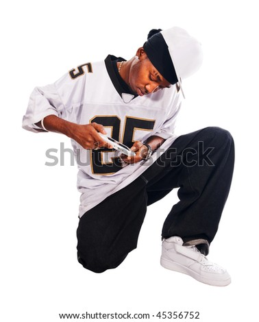 Cool hip-hop young man isolated on white playing on psp