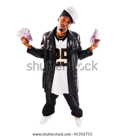 Cool hip-hop young man with lots of cash isolated on white