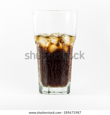 Cool ice cola in big glass.