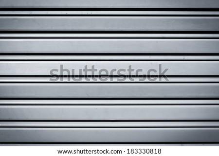 Cool industrial metal door background with dark corners - stock photo