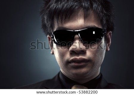 Cool japanese man in sunglasses portrait.