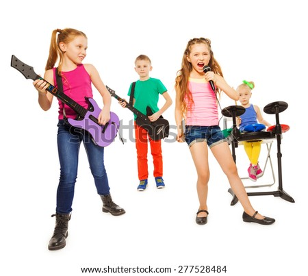 Cool kids play musical instruments as rock group - stock photo
