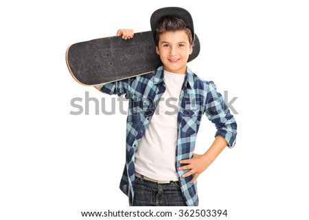 Cool little boy carrying a skateboard over his shoulder and looking at the camera isolated on white background - stock photo