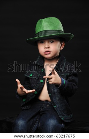 Cool little boy in a fancy hat counting using his fingers - stock photo