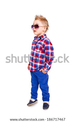 Cool little boy posing on  white background