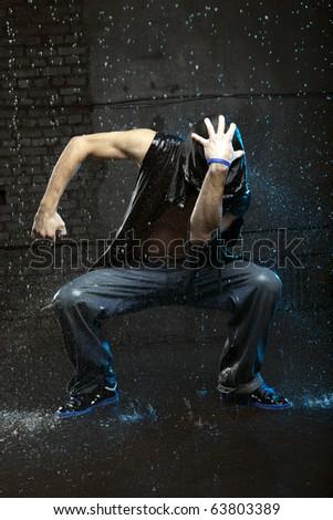 Cool looking dancer in aqua studio - stock photo